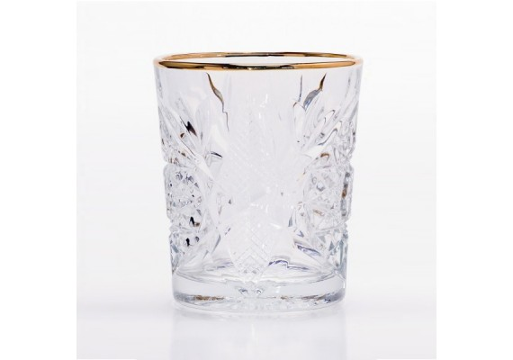 Cocktail glass with a golden rim